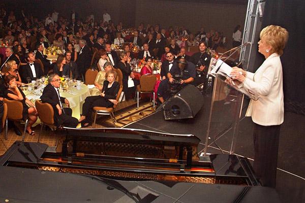 Sheila addressing crowd at 25th Anniversary Gala